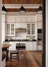 glass building kitchen cabinets. glass cabinets with solid cabinet doors on top. love the floors building kitchen h