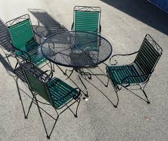 wrought iron vinyl strap chairs with wi