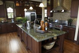 custom kitchen with green granite counters
