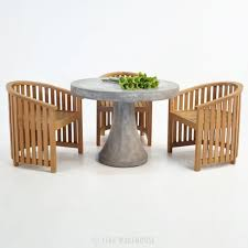 round concrete table with teak tub chair outdoor dining set 0