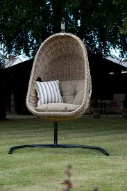 brown wicker outdoor furniture dresses: attractive bedroom with brown hanging rattan chair design winsome backyard decoration plus seat also stripe pillow
