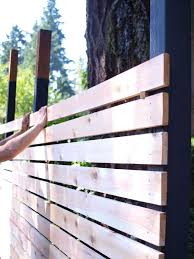Want to build a beautiful and functional mid-century modern fence? Here's  how.