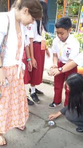 environmental child iers inside primary school students demonstrating how biopore works credit kelsie prabawa sear