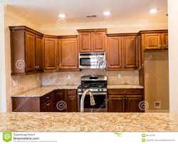 oak kitchen cabinets with granite countertops. Dark Wood Cabinets And Granite Countertops Oak Kitchen With A