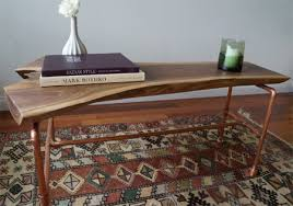Here's a copper pipe coffee table with a beautiful piece of walnut as the  top. But the technique used for this assembly was to solder the pipes, ...