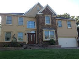 a residential homeowner in sewell nj replaced all the windows in the front of the house in order to remove the old windows they had to cut out the stucco