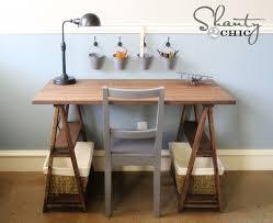 A DIY sawhorse trestle desk.