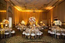 champagne uplighting by beyond creates a soft and romantic reception at the adolphus hotel in dallas wedding lightingballroom