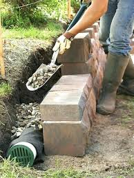 building retaining wall a using landscape timbers build timber steps on slope building a retaining wall