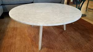marble round coffee table w blonde legs
