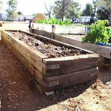 raised garden beds with railroad ties