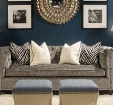 dark teal wall with grey and off white just add dark brown sofasfurniture theatre blue walls brown furniture
