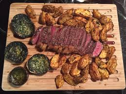 homemade dry aged steak garlicky parsley er mushrooms and spicy wedges