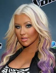 Christina Aguilera in pink top. After working on several television series she first launched her debut album in the year of 1999. - Christina-Aguilera-2