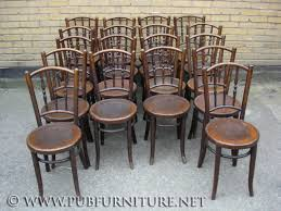 an image of pin or spindle type thonet bentwood chairs