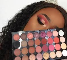 it has diffe shades of mostly pinks but it still has clic whites browns black s and shimmers i love this palette its beautiful