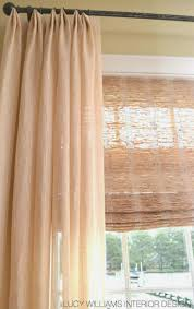Love the blinds with a sheer drape