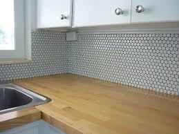 good wood countertop and penny tile backsplash in love with penny backsplash