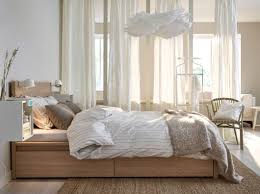 Light Brown And White Bedroom A Bed In Oak With Bed Textiles In White Beige And Light