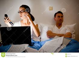 this couple is fighting because she`s working too much stock photo this couple is fighting because she`s working too much