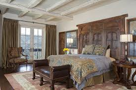 mediterranean bedroom with a unique headboard crafted from antique afghan window design john malick