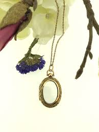 a yellow gold vintage glass locket