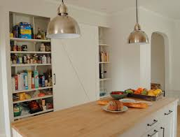 pantry with barn door farmhouse kitchen