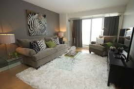 dark grey walls with white ceilings and hardwood flooring for a trendy living room paint
