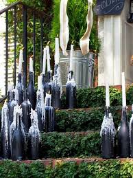 awesome and innovative diy wine bottle candle sticks for garden decor