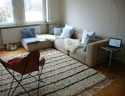 white rug with black lines rug in classic white with black lines and small bits of