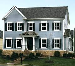 blue house white trim dark blue siding with white shutters blue house white trim black shutters