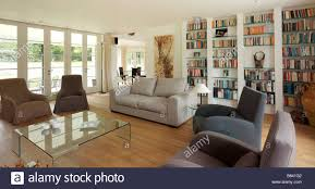 neutral furniture. Modern Living Room With Neutral Furniture And Large Wall Book Case Glass Coffee Table V