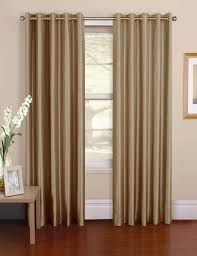 dressing your windows with eyelet curtains silk installed in the window of a house