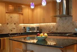 granite countertop is emerald pearl with full bull nose edge custom ceramic tile backsplash includes decorative metal inserts