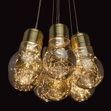 interior view loft pendant light in gold with 7 bulb shaped smoky shades with led wire save
