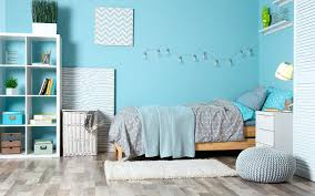 bedroom painted with blue colour