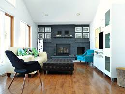 living room with dark painted fireplace focal wall dans le lakehouse on remodelaholic
