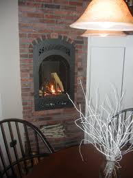brick tile kitchen fireplace wall with extra black and white in the color mix or contrast