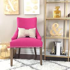 living room desk chair. stylishpetite.com | pink accent chair, gold shelves, striped bow pillow, living room desk chair