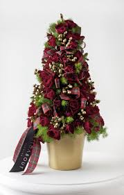 Tartan floral Christmas tree. Design and flowers by Wildabout. Photography  by Mark Bothwell.