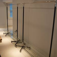 bespoke free standing clothes rack with low level glass shelf custom made hanging clothes rail for retail boutique dolly lloyd