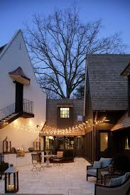 patio with fairy lights and outdoor kitchen view full size