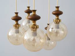 Cascade Lamp Made Of Brass Glass And Wood Ball Hanging Lamp Amber