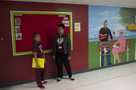 university of chicago charter schools north kenwood oakland campus first year teacher mel georgiou has a hallway chat a fifth grade student who was