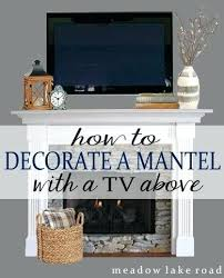 tv above fireplace decorating ideas mantle barn doors over fireplace mantels with tv above decorating ideas