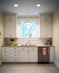 lighting over kitchen sink. pendant light above sink patterned wallpaper white cabinets and lighting over kitchen