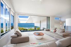 furniture for beach houses. Furniture Beach House Living Room With Modern Beige Loveseat And Decor Lounge Chair Round Coffe Table Style Designs Beachfront Wall Art Ranch Plans Nautical For Houses