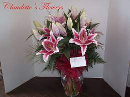 pretty pink lilies by Claudette's Flowers and Gifts