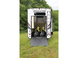 grand design momentum 376th toy hauler carrying two powersports toys