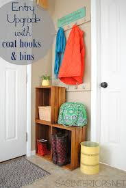 Easy Entry Upgrade with DIY built-in coat hooks and wooden crates via  @Jenna_Burger